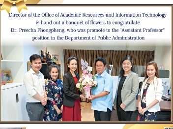 Director of the Office of Academic Resources and Information Technology Gave a bouquet of flowers to congratulate Dr. Preecha Phongpheng, who was appointed to the position